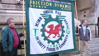 TGWU members holding a Friction Dynamex branch banner