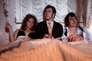in_pictures Carol Cleveland as Dora, Eric Idle as the newsreader, and Terry Jones as Bevis in the sketch Newsreader Arrested/Romantic Film. This sketch was originally used in Monty Pythons Flying Circus Series one.