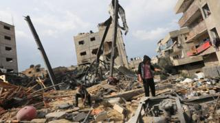 A Palestinian stands amidst the rubble of the building housing the Hamas-run television station al-Aqsa TV, destroyed by an Israeli air strike earlier this week, in the Gaza Strip on November 14, 2018