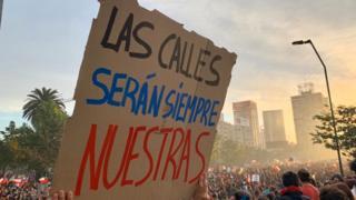Pancarta en Santiago.