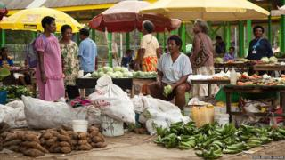 Market traders selling vegetables in Port Moresby, capital of Papua New Guinea
