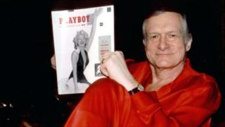 Playboy founder Hugh Hefner with the first copy of the magazine. File photo
