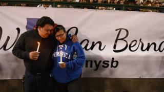 Mourners at a vigil in San Bernardino