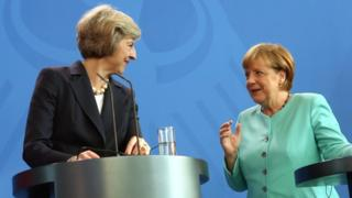 German Chancellor Angela Merkel (r) and British Prime Minister Theresa May hold a joint news conference in Berlin on 20 July 2016 .