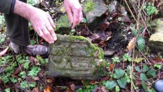 Verger Christopher Marshall found one of the cross fragments in St James' Church rectory garden