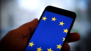 A smartphone with the flag of the European Union on its screen