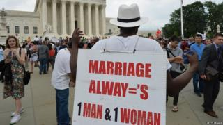 A man protests gay marriage outside the Supreme Court.