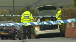 Police at the scene in Llay