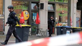 Policemen secure the area around a doner kebab restaurant, site of a shooting in Halle