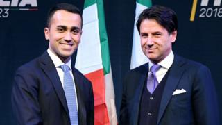 Leader of the Italy's populist Five Star Movement, Luigi Di Maio (L), shakes hands with Italian lawyer Giuseppe Conte, 1 March 2018