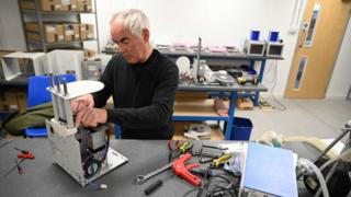 Medical ventilators are constructed at the OES medical supply company in Witney, central Britain, 23 March 2020.
