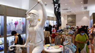 """Two-meter-tall """"Lady Liberty"""", a symbolic statue placed by pro-democracy protesters, stands in a Chickeeduck branch in Hong Kong,"""