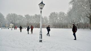 "Pedestrians walk through Queen""s Square in Bristol after heavy snowfall"