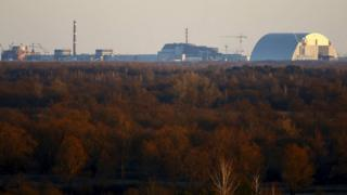 Chernobyl nuclear power station, seen from a tower in the exclusion zone around the nuclear reactor, in the abandoned village of Krasnoselie