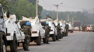 A picture taken in Bouake on January 6, 2017 shows an UN Blue Helmet peacekeepers convoy parked at the entrance of the city where soldiers demanding more pay and housing rose up earlier in the day.