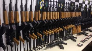 Handout image released by Brazilian Civil Police showing 60 firearms seized from inside shipments of pool heating systems from Miami on June 1, 2017