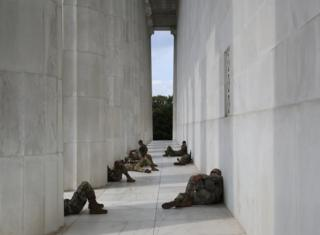 Members of the National Guard take a break from the heat at the Lincoln Memorial while protesters demonstrate against police brutality and racism on June 6, 2020 in Washington, DC