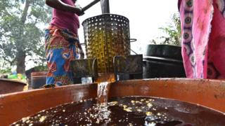 Woman making palm oil
