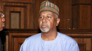 Former National Security Adviser Sambo Dasuki (R) arrives with one of his counsels Ahmed Raji at the Federal High Court in Abuja, Nigeria, September 1, 2015