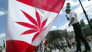 Marijuana activist Chris Lawson makes a speech on stage during a rally in support of legalizing marijuana on June 5, 2004 on Parliament Hill in Ottawa, Canada. The Supreme Court of Canada recently upheld a decision to keep marijuana as a banned substance.