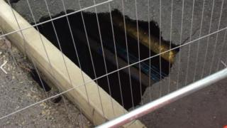 The sinkhole exposed pipes