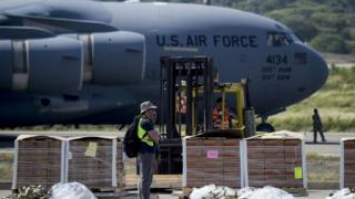Food and medicine aid for Venezuela is unloaded from a US Air Force C-17 aircraft at Camilo Daza International Airport in Cucuta, Colombia in the border with Venezuela on February 16, 2019.