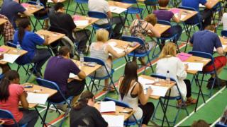 teenagers sitting GCSE exams