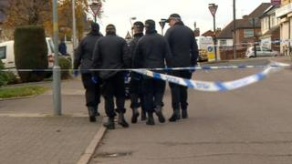 Police at the cordoned-off scene