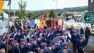 Orange Order lodges and bandsmen march up the Crumlin Road in north Belfast on Saturday morning