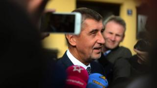 Czech billionaire Andrej Babis, chairman of the ANO movement, talks to the media after voting at a polling station