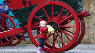 Sixteen-month-old Georgie Mayberry-McKay from Campbeltown helps clean a cart