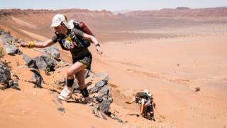 Sophie Raworth climbing up a sand dune at the Marathon des Sables