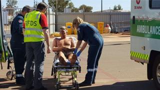 Anthony Collis, 32, being treated by rescue crew