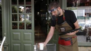 waiter-serving-in-ppe