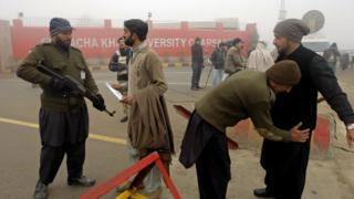 Police search student entering campus of Bacha Khan University. 25 Jan 2016