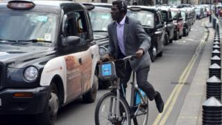 man on boris bike