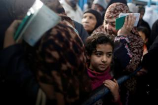 Palestinian refugees wait to receive aid at a United Nations food distribution centre in Al-Shati refugee camp in Gaza City January 15, 2018