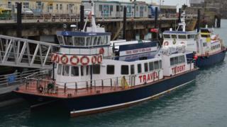 Travel Trident V alongside in St Peter Port Harbour