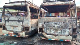 A picture taken on July 10, 2018 shows burned busses at the bus terminal in Buea. - Gunfire broke out on July 9 in Buea, the capital of a western region of Cameroon gripped by violence between anglophone separatists and security forces