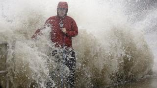 TV reporter caught in storm