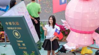 2018/10/10: A young woman standing on a float during the celebration of the 107 birthday of the Republic of China in Taipei, Taiwan, known also as double Ten celebrations.