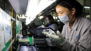 A computer plant building a laptop