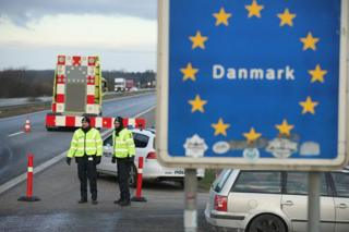 Danish police conducting spot checks on incoming traffic from Germany stand at the A7 highway border crossing near Padborg, Denmark