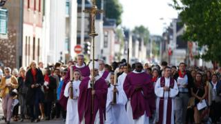 Archbishop Dominique Lebrun leads a procession through Saint-Etienne-du-Rouvray, France, prior to a special Mass. 2 Oct 2017