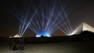Lights shine on the pyramids during New Year's Day celebrations on the outskirts of Cairo, Egypt.