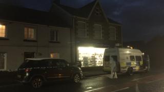 Police at Garnant Pharmacy