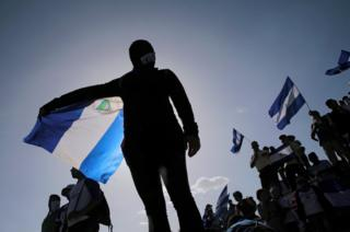 An anti-government protester takes part in a protest to demand the release of demonstrators detained during recent protests against Nicaraguan President Daniel Ortega's government in Managua. Nicaragua