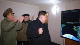 Kim Jong-un celebrates the launch of a Hwasong-15 missile