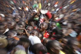 """Supporters of Raila Odinga, the leader of The National Super Alliance (NASA) opposition coalition and its presidential candidate, cheer as they listen to Odinga""""s speech during his campaign rally in Nairobi, Kenya, 17 September 2017. Odinga once again reiterated that opposition will not take part in presidential election re-run unless the electoral body Independent Electoral and Boundaries Commission (IEBC) is reconstituted by removing some of its officials. The presidential election re-run is set for 17 October 2017."""