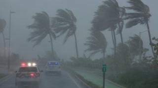 Police patrol the area as Hurricane Irma slams across islands in the northern Caribbean on Wednesday, in San Juan, Puerto Rico, 6 September